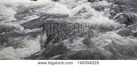 Wilson Creek flooding over boulders in North Carolina