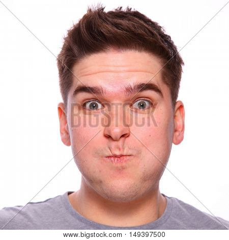 Twenty something brown haired man holding breath with pursed lips headshot