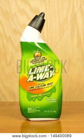 RIVER FALLS,WISCONSIN-SEPTEMBER 28,2016: A bottle of Lime-A-Way brand household cleaner with a wood background.