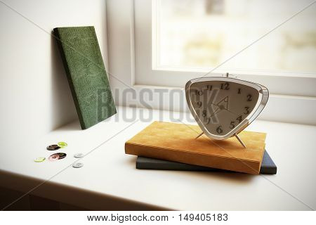 Book alarm clock and buttons on the window sill
