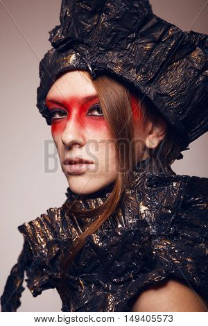 Woman with red make up in metal headwear