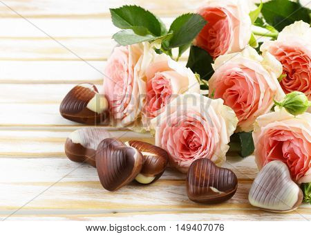 bouquet of pink roses and chocolate hearts for a gift for Valentine Day
