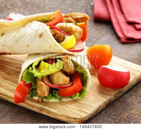 doner with chicken and vegetables in a tortilla