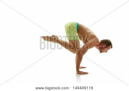 Male gymnast doing handstand. Isolated on white background