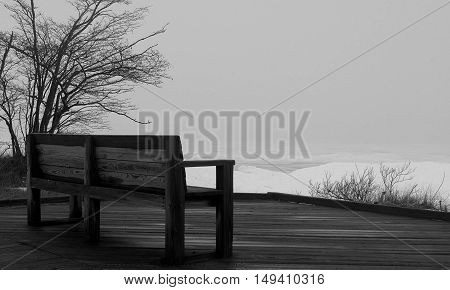 a bench overlooking frozen lake Superior in early spring