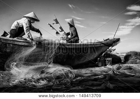 Hai Ly, Hai Hau, Vietnam - June 27, 2015: People are preparing for the fishing day at the beach