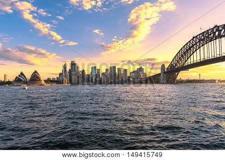 Sydney Harbour Bridge and Sydney Opera House NSW Australia at sunset. Sep 29,2016 the Sydney Opera House is one of the modern building, well known worldwide.Over 10 milions tourists visit Sydney a year.