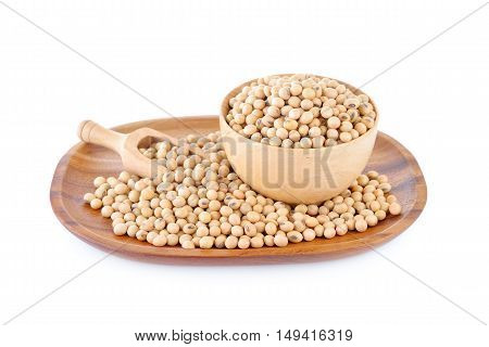 soybean in wooden bowl and plate on white background