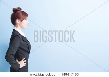 business woman is smile and arms akimbo with isolated on blue background asian