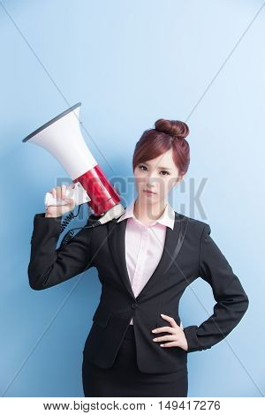 business woman take microphone angrily with isolated on blue background