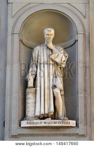 FLORENCE, ITALY - January 20, 2016: Niccolo Machiavelli ( italian florentine historian, politician, diplomat, philosopher ) statue by Lorenzo Bartolini on facade of Uffizi Gallery, Florence, Italy