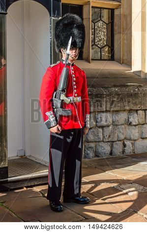 LONDON UK - AUGUST 21 2015: Queen's Guard - Tower of London. The Queen's Guard is the contingents of infantry and cavalry soldiers charged with guarding the official royal residences in the United Kingdom.