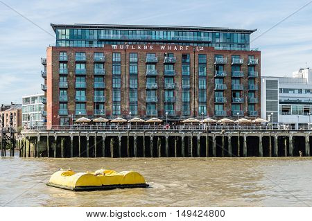 LONDON UK - AUGUST 22 2015: Butlers Wharf. It is an English historic building on the south bank of the River Thames just east of Tower Bridge now housing luxury flats and restaurants.
