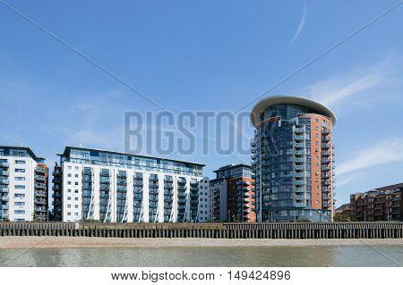 LONDON UK - AUGUST 22 2015: Modern housing in London riverside near Greenwich and Canary Wharf