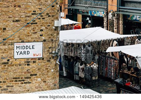 LONDON UK - AUGUST 20 2015: Camden Town Market famous alternative culture shops. Mainly tourist oriented selling souvenirs crafts and fashion products