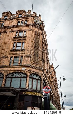 London UK - August 19 2015: Low angle view of Harrods Department Store. Harrods is the most famous and luxury department store in the world.