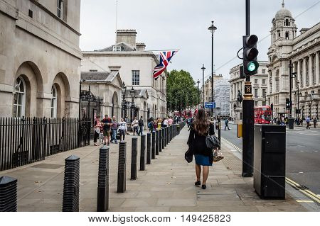 London UK - August 18 2015: Whitehall street in London a cloudy day. Tourist walking at the entrance of Household Guards building