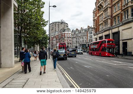 London UK - August 19 2015: Knightsbridge is an exclusive residential and retail district in central London is home to many expensive shops fashion houses and luxury apartments