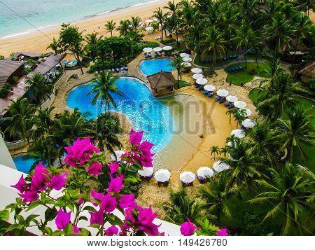 Bali, Indonesia - December 30, 2008: The pools and beach of ocean taken in Nusa Dua Grand Nikko Bali. Hotel is located in Nusa Dua, Bali.