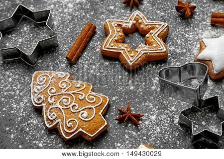 Delicious Christmas cookies with scattered powdered sugar on gray background