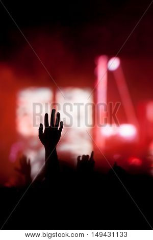 christian music concert with a raised hand