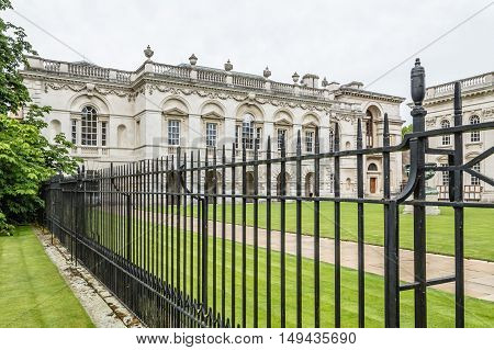CAMBRIDGE UK - AUGUST 11 2015: Iron fence in a College of the University of Cambridge. Cambridge is a university city and one of the top five universities in the world.
