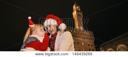 Mother And Child In Christmas Hats In Florence Talking On Mobile