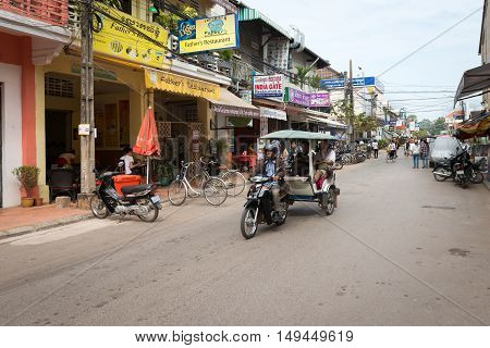 Tuk-tuk Tourist Taxi On The Central Street Of The Siem Reap