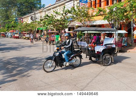 Tuk Tuk With A Trailer In A Cambodian Street.