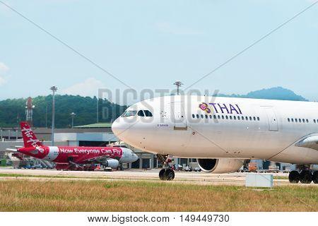 Thai Airways Passenger Plane Taxis To The Terminal At Phuket International Airport.