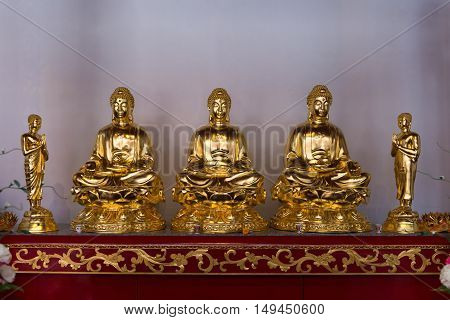 Five Gold Sculptures On An Altar At Canton Shrine