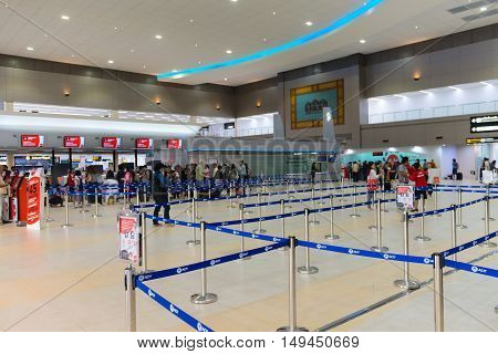 Passengers Queue Up At The Ticketing Counters Inside Don Mueang International Airport In Bangkok.