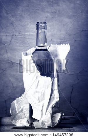 bottle of hard liquer in the paper bag