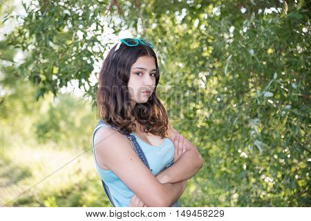 A Teen girl standing near the tree