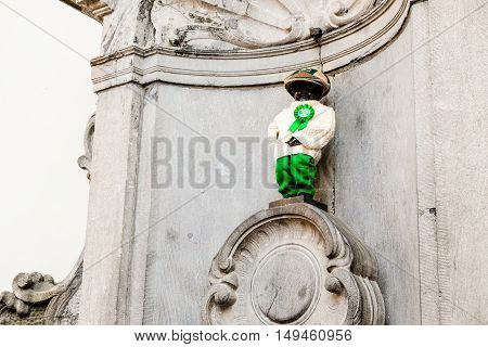 Manneken Pis is a landmark small bronze sculpture in Brussels depicting a naked little boy urinating into a fountain's basin.