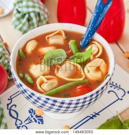 Rustic tomato soup with veggies and tortellini