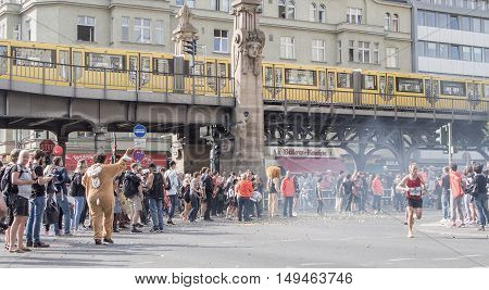 BERLIN GERMANY - SEPTEMBER 25 2016: Spectators And Runners At Berlin Marathon 2016 Train In Background