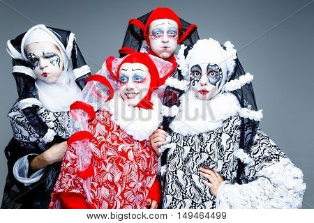 Four cheerful clown in a vintage style with a typical makeup