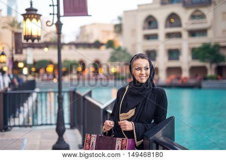 Young beautiful muslim woman shopping in the city.