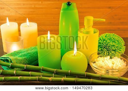 Macro view of green spa bath products concept with candles, flowers, bamboo