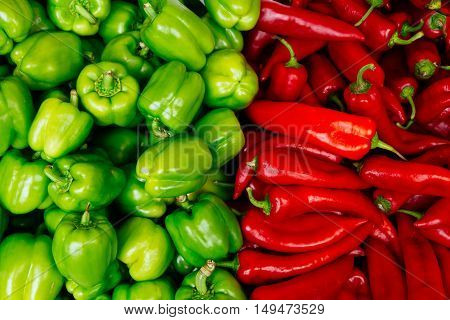 Red and green mix of the freshest peppers. Health food concept.