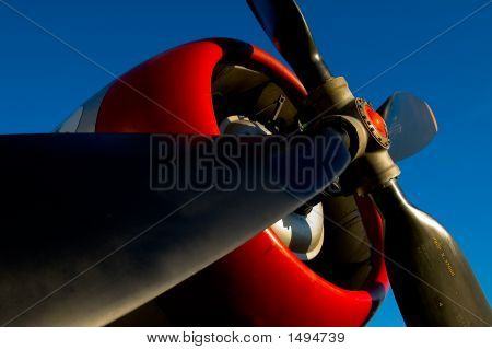 A four blade propeller of an airplane points into the sky poster