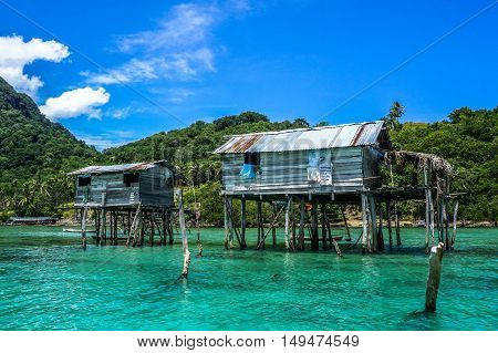 The beautiful sea gypsy water village in Mabul Bodgaya Island in Tun Sakaran marine park,Semporna,Sabah,Borneo,Malaysia.Clear blue water,sand & palm trees.Beautiful vacation spot,treatment & aquatics.