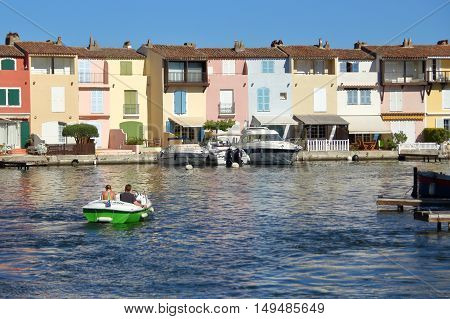 Port Grimaud, Provence, France - August 23 2016: Holiday Makers Enjoy A Ride In A Boat Around This P