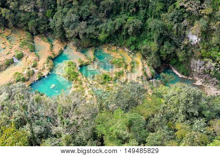 Beautiful turquoise pools and limestone bridges surrounded by the jungle in Semuc Champey in Alta Verapaz region Guatemala