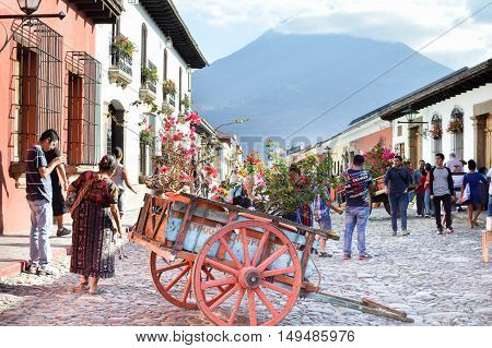 Antigua Guatemala - February 15 2015: Tourists and locals stroll the cobble stone streets of the beautiful colonial city of Antigua on a sunny day in Guatemala