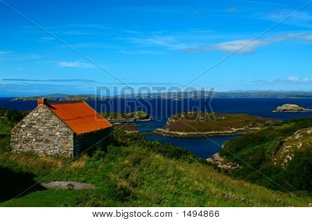 A Scenic Landcape With A Battered Old Tin Roofed House In The Foreground
