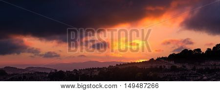 Sunset looking West over city of Bath. Panorama over UNESCO World Heritage City of Bath in Somerset England UK at dusk