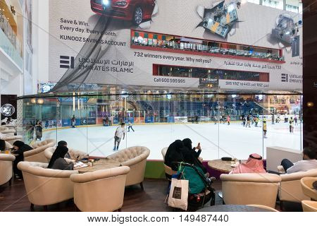 Dubai UAE - september 05 2016: Indoor Ice Rink at Dubai Mall in Dubai with large lounge chairs for spectators. The mall is the world's largest shopping mall.
