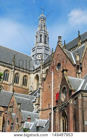 Haarlem, The Netherlands - June 5, 2014. Tower of Grote Kerk van St Bavo in Haarlem, with other architectural details of the building.